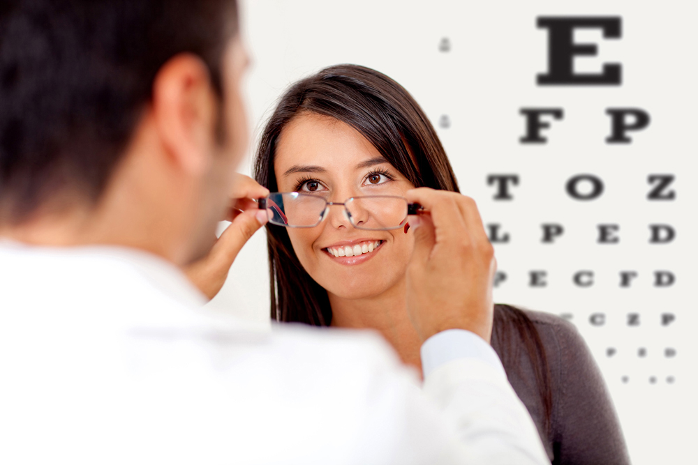Optometrists with patient